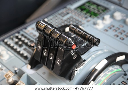 four jet airplane throttles in the cockpit - stock photo