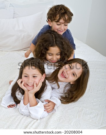 four kids piled on each other