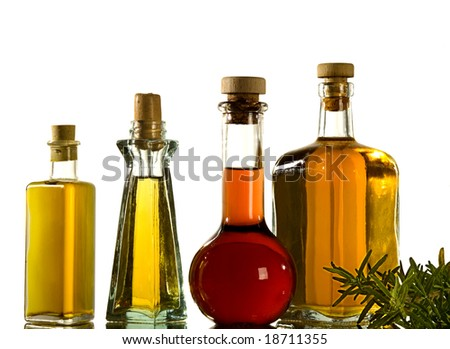 four kind of oil on a mirror - stock photo
