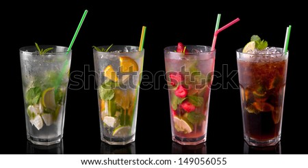 Four kinds of mojitos on a black background. - stock photo