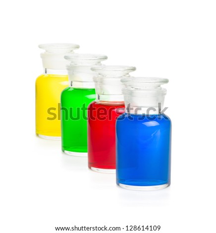 Four laboratory bottles filled with colorful liquids - stock photo