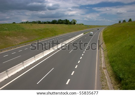 Four lane highway - stock photo