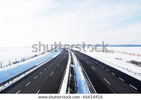 Four-lane highway in winter at Lake Balaton, Hungary - stock photo