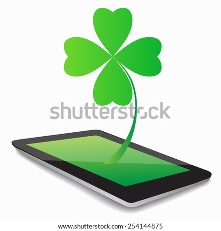 Four- leaf clover - Irish shamrock St Patrick's Day symbol. Useful for your design. Green glass clover  on white background.Stylish abstract St. Patrick's day  leaf clover whit tablet computer. - stock photo