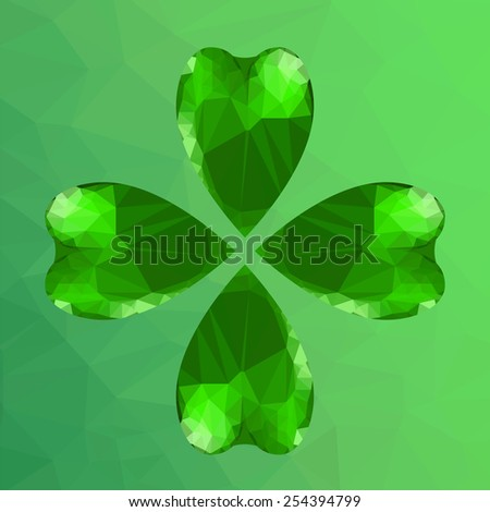 Four- leaf clover - Irish shamrock St Patrick's Day symbol. Useful for your design. Green glass clover. St. Patrick's day green leaf  on green polygonal background. - stock photo