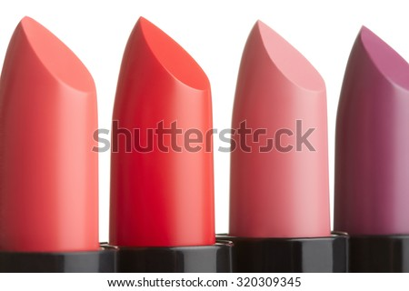 Four lipstick collection in coral, red, pink, purple, color isolated on white, clipping path included