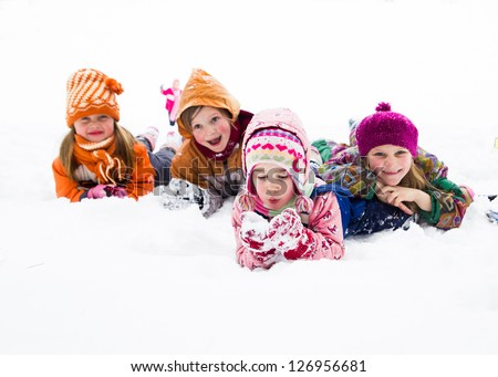Four little kids playing in snow - stock photo