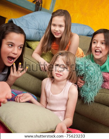Four little outraged girls at a sleepover - stock photo