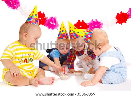 Four lovely toddlers at the birthday party - stock photo