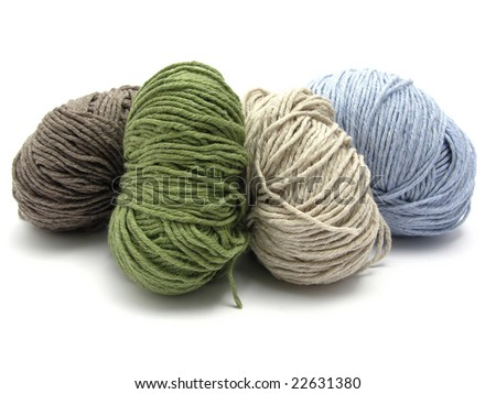 Four lying balls of wool