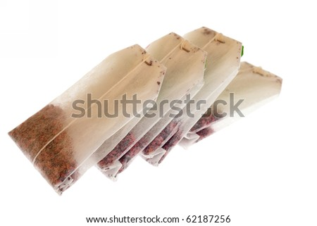 four Lying Teabags - tea-bag isolated on white - stock photo