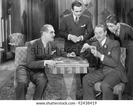 Four men playing cards - stock photo