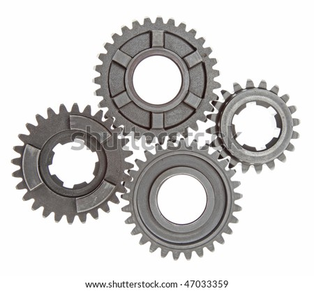 Four metal gears linked together on a white background. - stock photo