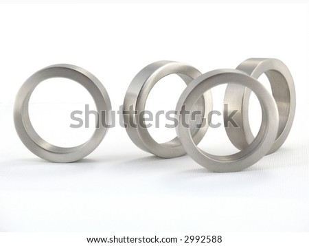 Four Metal Rings; Isolated; macro - stock photo