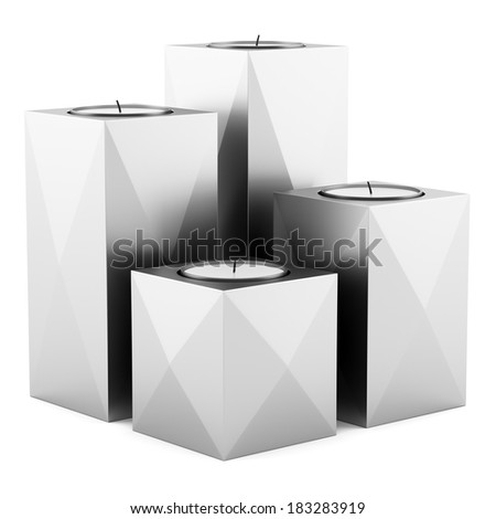 four metallic candlesticks with candles isolated on white background