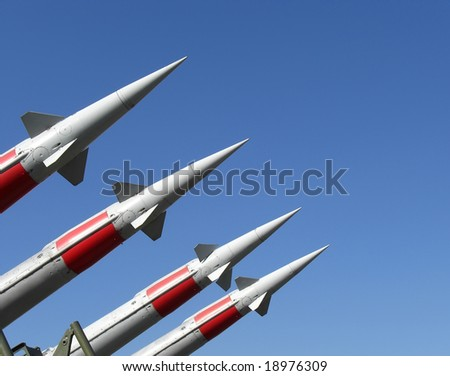 Four missiles against clear blue sky - stock photo