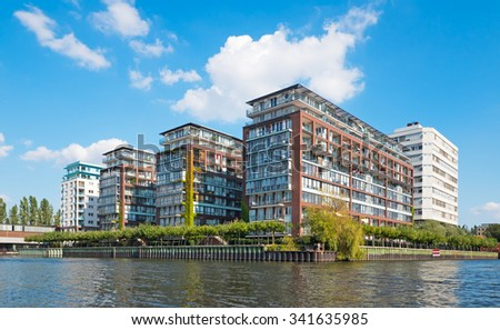 Four modern apartment buildings at a waterfront - stock photo