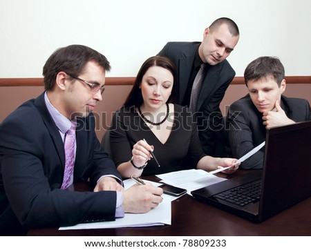 Four modern businessman at the meeting in the office - stock photo