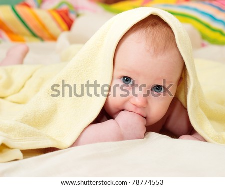 Four month little baby girl in yellow towel