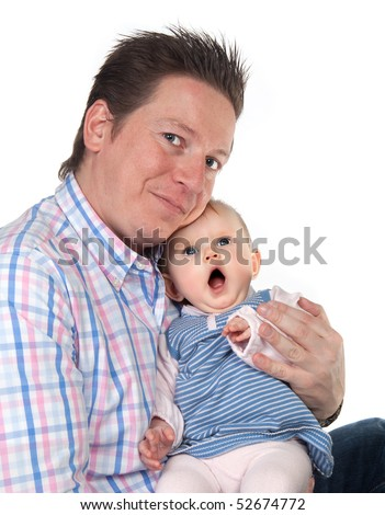 Four months old baby girl sitting on her father's lap - stock photo