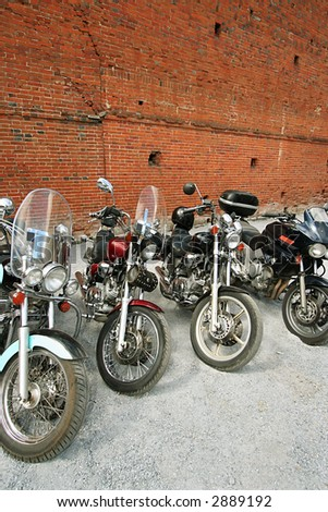 Four motorcycles on a background of a brick wall