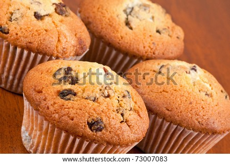Four muffins on the table - stock photo