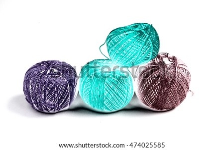 Four multicolored balls of threads for knitting on a white background. Home work. grandmother's knitting.