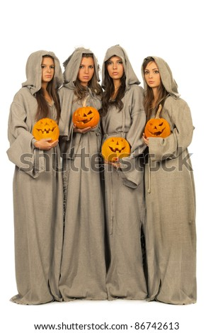 Four nuns with halloween pumpkins in their hands - stock photo