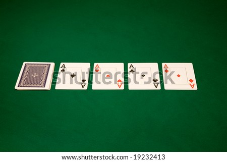 Four of a kind Aces in Las Vegas casino on the green table - stock photo