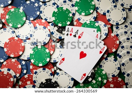 four of a kind poker hand Aces and many chips - stock photo