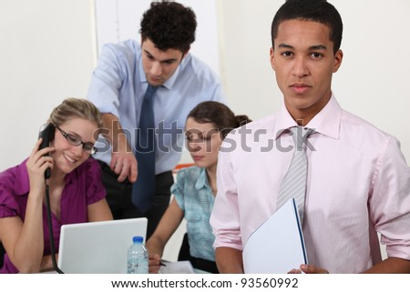 Four office colleagues - stock photo