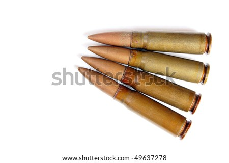 Four old and messy bullets isolated on white background - stock photo