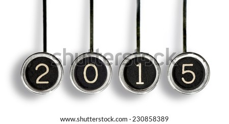 "Four old, scratched chrome typewriter keys with black centers and white letters spelling out ""2015"". With drop shadow, isolated on white."