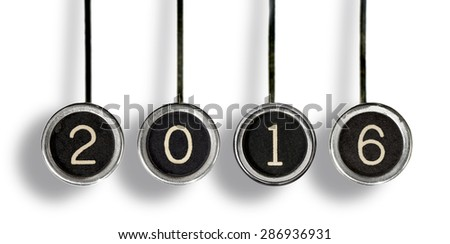 Four old, scratched chrome typewriter keys with black centers and white numbers representing the year, 2016.  Isolated on white. - stock photo