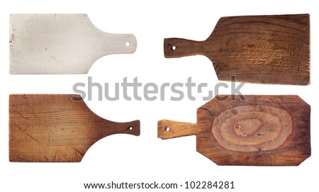 four old used chopping kitchen boards, isolated over white - stock photo