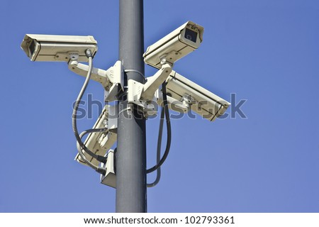 Four outside security cameras cover multiple angles. - stock photo