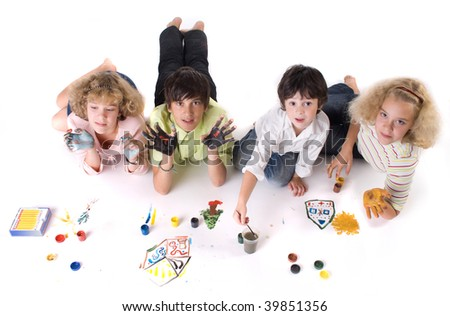 Four painting child (two boy and two girl) - stock photo