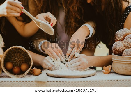 four pair of Hands kneading dough  - stock photo