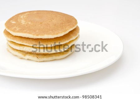 Four pancakes on a white plate