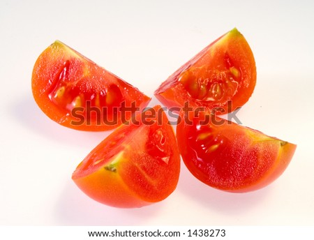 Four parts cutted tomato - stock photo