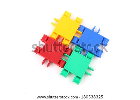 Four parts strongly connected to each other to symbolize teamwork - stock photo