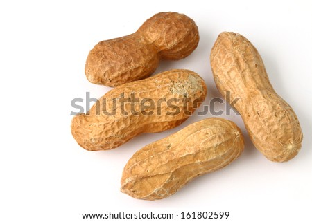 Four peanuts in their shell isolated on white - stock photo