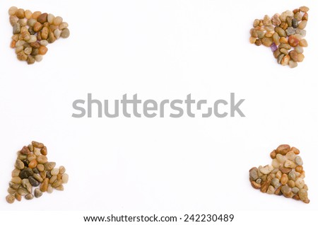 Four pebbles heart in image corners (isolated on white) - stock photo