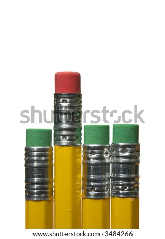 Four pencil erasers - red eraser standing out between green erasers