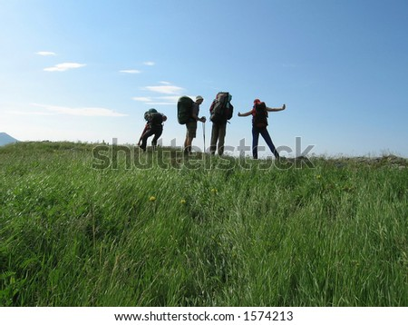 Four people about horizon - stock photo