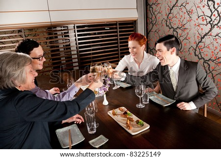 Four people celebrating - stock photo