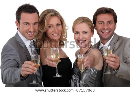 Four people toasting success