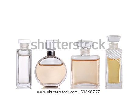 Four Perfume bottles (with clipping paths) - stock photo