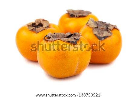 Four persimmon fruits isolated on the white background