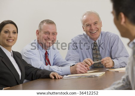 Four person business team in meeting - stock photo